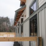 Rear elevation of the barn  – Stall runouts, profiled rafter tails, zinc-coated copper roof and gutters.