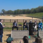 Aleco Bravo-Greenberg unveils new entrance signs for Woodstock Equestrian Park featuring the addition of Herman Greenberg's name, his late father, who graciously donated the land for the purposes of an equestrian park.  Aleco spoke on behalf of the Rickman and Greenberg family thanking everyone for their hard work and dedication to seeing the project to fruition.