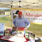 Ross Peddicord on duty at the Maryland Horse Industry Board's tent during the grand opening ceremonies of Woodstock Equestrian Park.  Ross was responsible of raising awareness of Maryland's HIB.