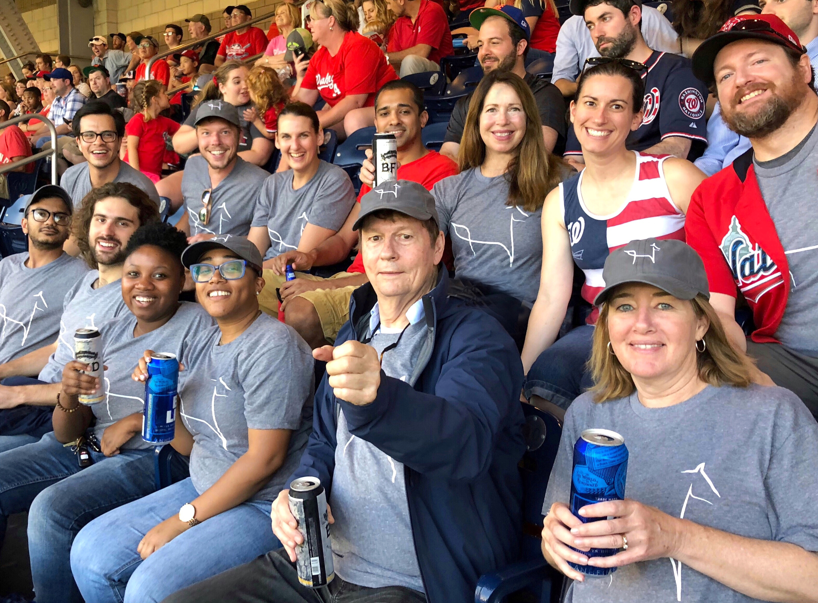 Smiling faces of Blackburn employees at a Nationals baseball game